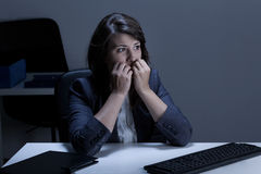 Stressed out businesswoman biting nails. Portrait of stressed out businesswoman biting nails stock photography