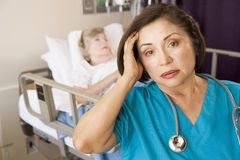 Stressed Out Doctor In Patients Room Stock Photography