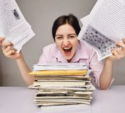 Exhausted woman at work Royalty Free Stock Images