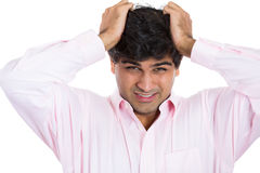 Really stressed out guy with headache, wearing pink shirt Stock Photos