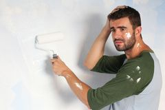 Stressed out male painting his home with space for copy.  Royalty Free Stock Images
