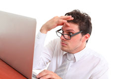 Stressed out man with computer. On white background Stock Photos