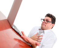 Stressed out man with computer Stock Photo