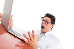 Stressed out man with computer Royalty Free Stock Image