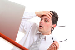 Stressed out man with computer. On white background Royalty Free Stock Photo
