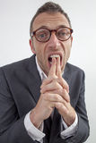 Stressed out manager touching his teeth for corporate question or frustration Stock Photography
