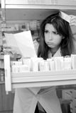 Stressed out pharmacist at work Stock Image