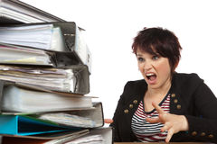 Stressed Out Woman At Work. Stressed Out Worker At Her Desk With Files On White Isolated Background Stock Photography