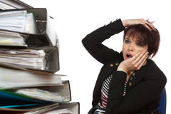 Stressed Out Woman At Work. Stressed Out Worker At Her Desk With Files On White Isolated Background Royalty Free Stock Photo