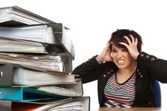 Stressed Out Woman At Work. Stressed Out Worker At Her Desk With Files On White Isolated Background Royalty Free Stock Photos