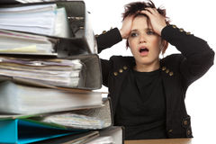 Stressed Out Woman At Work. Stressed Out Worker At Her Desk With Files On White Isolated Background Royalty Free Stock Photography