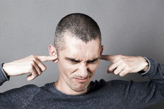 Stressed out young man to refuse to listen to problems Royalty Free Stock Photo