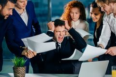 Stressed Businessman in office scream, upset with employees ask for attention. Stressed and overworked business owner. Businessman in modern office scream Stock Images
