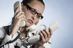 Stressed phone operator. Royalty Free Stock Photo