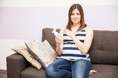 Stressed pregnant woman with breast pump Royalty Free Stock Photo