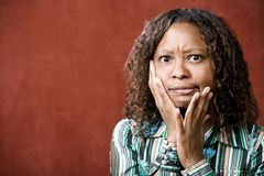 Stressed Pretty African-American Woman. Close-Up Portrait of a Stressed African-American Woman Royalty Free Stock Photography
