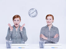 Stressed and relaxed worker. Sitting at desk Royalty Free Stock Image