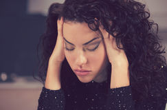 Stressed sad housewife sitting in modern kitchen Royalty Free Stock Photo