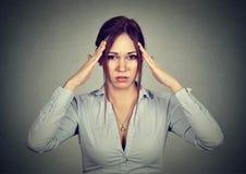 Stressed sad woman with headache Stock Photography