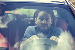 Stressed scared man driver. Inexperienced anxious motorist Royalty Free Stock Image