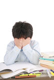 Stressed schoolboy studying in classroom Royalty Free Stock Photography