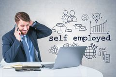 Stressed self employed man on phone. Stressed young man in suit talking on smartphone and looking at laptop over concrete wall background with self employed stock illustration