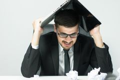Stressed Senior businessman holding document binders on his head. Unsuccessful overworked people Royalty Free Stock Photo