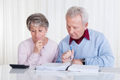 Stressed senior couple calculating budget Stock Image