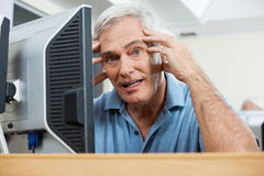 Stressed Senior Man During Computer Class Royalty Free Stock Images