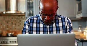 Stressed senior man using laptop. At home stock footage