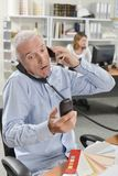 Stressed senior office worker royalty free stock image