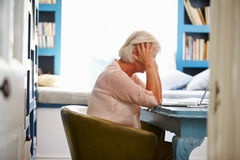 Stressed Senior Woman At Desk In Home Office With Laptop Royalty Free Stock Photo