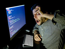 Stressed software developer with computer at home office Stock Images