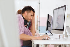 Stressed software developer at office Royalty Free Stock Image