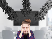 Stressed student and arrows of question marks Royalty Free Stock Photos