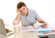 Stressed Student with Book and Laptop Stock Photo