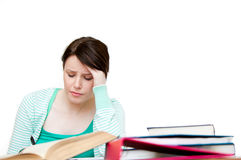 Stressed student doing her homework Stock Images