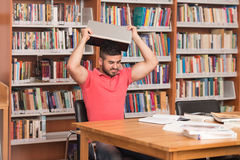 Stressed Student Doing His Homework At The Desk. Arabic Male College Student Stressed About His Homework Stock Images