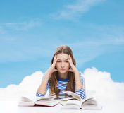 Stressed student girl with books Stock Images