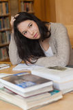 Stressed student in a library Stock Image