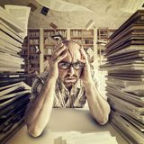 Stressed student portrait. In library royalty free stock photography