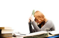 Stressed student revising for an exam Royalty Free Stock Photos