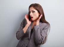 Stressed surprising business woman in suit with hand near face l Royalty Free Stock Image
