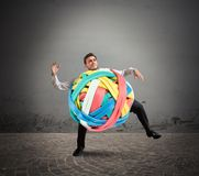 Stressed tangle. Businessman with a tangle of rubber bands Royalty Free Stock Photo