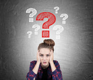 Stressed teen girl and questions, blackboard Stock Photos