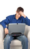 Stressed Teenager with Laptop. On the White Background Stock Photo