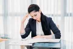 Tired business woman studying report papers office. Stressed tired business woman. young lady focused on studying report papers and marketing statistics. office Stock Photo