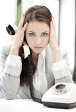Stressed and tired businesswoman with cell phone Stock Images