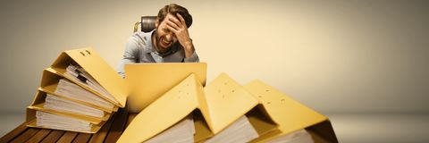 Stressed and tired man with lots of files table Stock Images