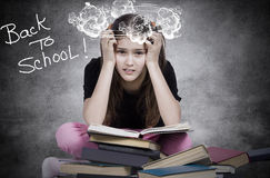 Stressed, tired, overwhelmed little girl, student, pupil royalty free stock image
